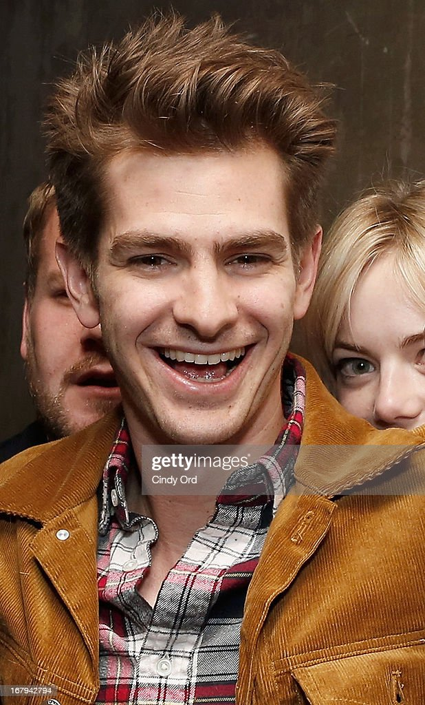 Actors <a gi-track='captionPersonalityLinkClicked' href=/galleries/search?phrase=Andrew+Garfield&family=editorial&specificpeople=4047840 ng-click='$event.stopPropagation()'>Andrew Garfield</a> and Emma Stone (back right) attend the Opening Night Of The US Premiere Of 'BULL At Brits' Off Broadway After Party at 59E59 Theaters on May 2, 2013 in New York City.