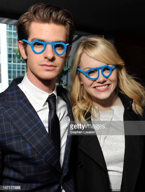 Actors Andrew Garfield and Emma Stone attend the WWO cocktail honoring Dr Jane Aronson at The Royalton Hotel on June 26 2012 in New York City