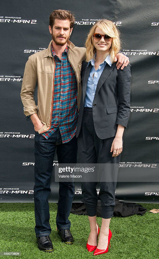 Actors Andrew Garfield and Emma Stone pose at 'The Amazing Spiderman 2' Los Angeles Photo Call at Sony Pictures Studios on November 16, 2013 in Culver City, California.