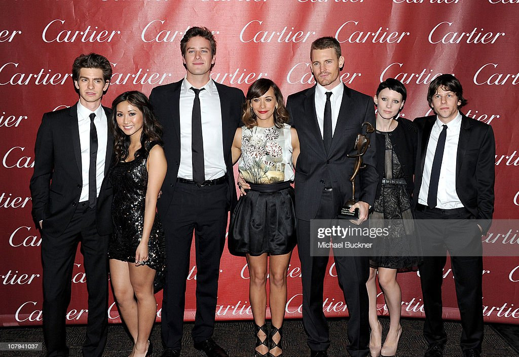 Actors Andrew Garfield, Brenda Song, Armie Hammer, Rashida Jones, Josh Pence, Rooney Mara, and Jesse Eisenberg pose backstage with the Ensemble Performance Award at the 22nd Annual Palm Springs International Film Festival Awards Gala at the Palm Springs Convention Center on January 8, 2011 in Palm Springs, California.
