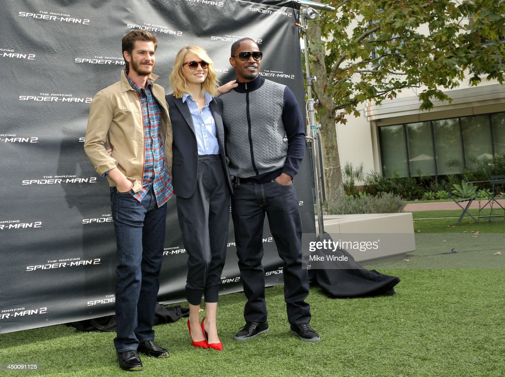 Actors <a gi-track='captionPersonalityLinkClicked' href=/galleries/search?phrase=Andrew+Garfield&family=editorial&specificpeople=4047840 ng-click='$event.stopPropagation()'>Andrew Garfield</a>, <a gi-track='captionPersonalityLinkClicked' href=/galleries/search?phrase=Emma+Stone&family=editorial&specificpeople=672023 ng-click='$event.stopPropagation()'>Emma Stone</a> and <a gi-track='captionPersonalityLinkClicked' href=/galleries/search?phrase=Jamie+Foxx&family=editorial&specificpeople=201715 ng-click='$event.stopPropagation()'>Jamie Foxx</a> attend 'The Amazing Spiderman' fan event at Sony Pictures Studios on November 16, 2013 in Culver City, California.