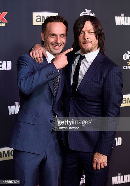 Actors Andrew Lincoln and Norman Reedus attend the season 5 premiere of 'The Walking Dead' at AMC Universal City Walk on October 2 2014 in Universal...