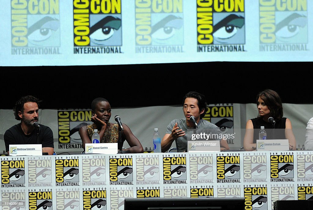 Actors Andrew Lincoln, Danai Gurira, Steven Yeun and Lauren Cohan speak onstage at AMC's 'The Walking Dead' panel during Comic-Con International 2013 at San Diego Convention Center on July 19, 2013 in San Diego, California.