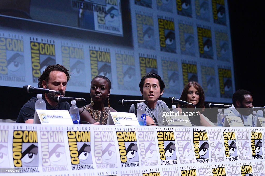 Actors Andrew Lincoln, Danai Gurira, Steven Yeun, Lauren Cohan and Chad L. Coleman speak onstage at AMC's 'The Walking Dead' panel during Comic-Con International 2013 at San Diego Convention Center on July 19, 2013 in San Diego, California.