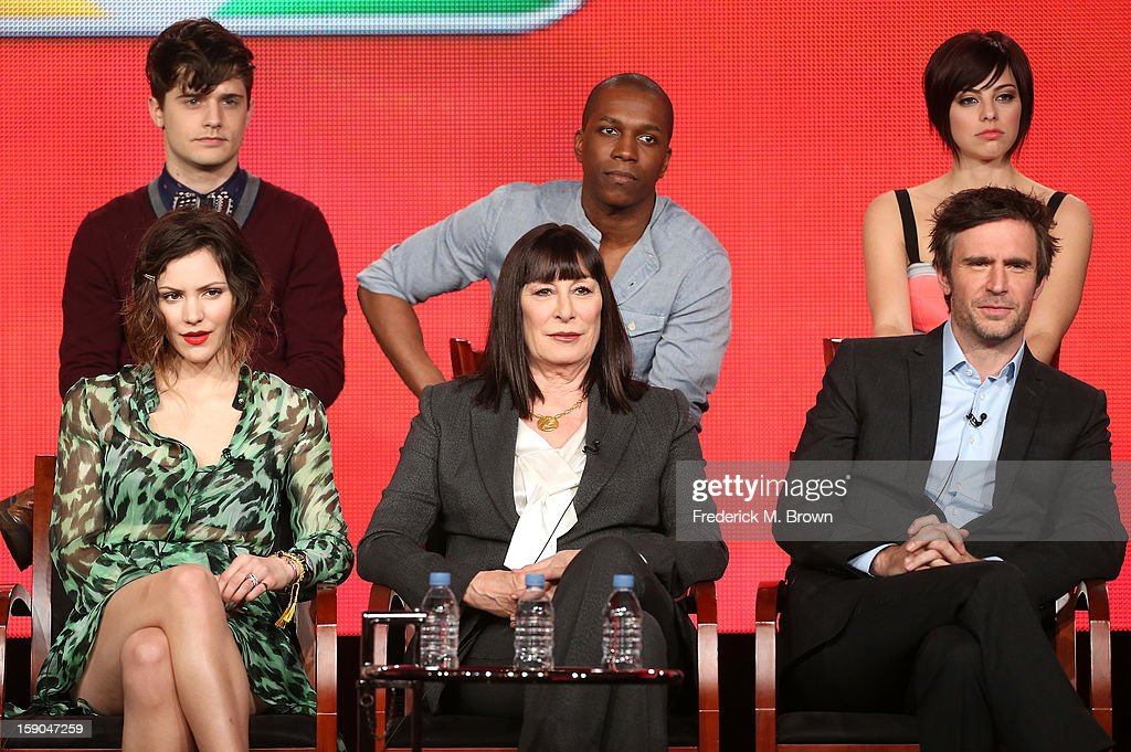 Actors Andy Mientus, Leslie Odom Jr., and Krysta Rodriguez, (Bottom L-R) actors Katharine McPhee, Anjelica Huston, and Jack Davenport speak onstage during the 'Smash' panel discussion at the NBCUniversal portion of the 2013 Winter TCA Tour- Day 3 at the Langham Hotel on January 6, 2013 in Pasadena, California.