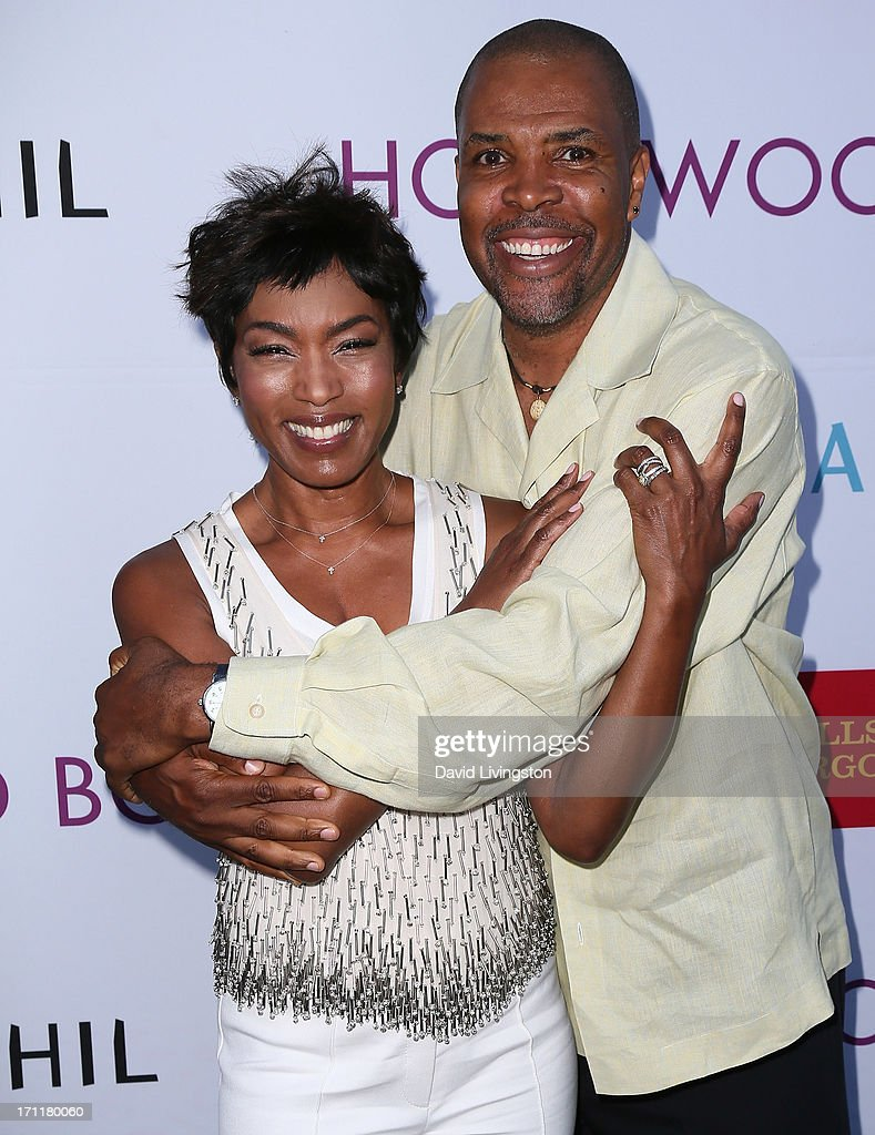 Actors Angela Bassett (L) and Eriq La Salle attend Opening Night at The Hollywood Bowl 2013 at The Hollywood Bowl on June 22, 2013 in Los Angeles, California.