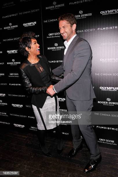 Actors Angela Bassett and Gerard Butler attend The Cinema Society with Roger Dubuis and Grey Goose screening of FilmDistrict's 'Olympus Has Fallen'...