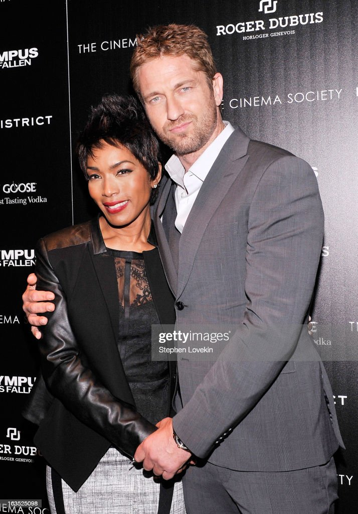 Actors <a gi-track='captionPersonalityLinkClicked' href=/galleries/search?phrase=Angela+Bassett&family=editorial&specificpeople=171174 ng-click='$event.stopPropagation()'>Angela Bassett</a> and <a gi-track='captionPersonalityLinkClicked' href=/galleries/search?phrase=Gerard+Butler&family=editorial&specificpeople=202258 ng-click='$event.stopPropagation()'>Gerard Butler</a> attend The Cinema Society with Roger Dubuis and Grey Goose screening of FilmDistrict's 'Olympus Has Fallen' at Tribeca Grand Hotel on March 11, 2013 in New York City.
