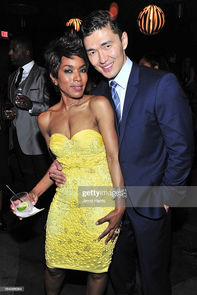 Actors Angela Bassett and John Cho attend 'Olympus Has Fallen' Premiere Reception presented by Grey Goose Vodka at Lure on March 18, 2013 in Hollywood, California.