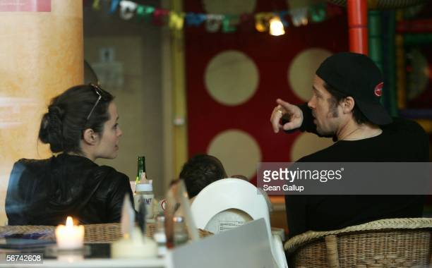 Actors Angelina Jolie and boyfriend Brad Pitt sit in the Pups family restaurant with Jolie's adopted children Maddox and Zahara February 4 2006 in...