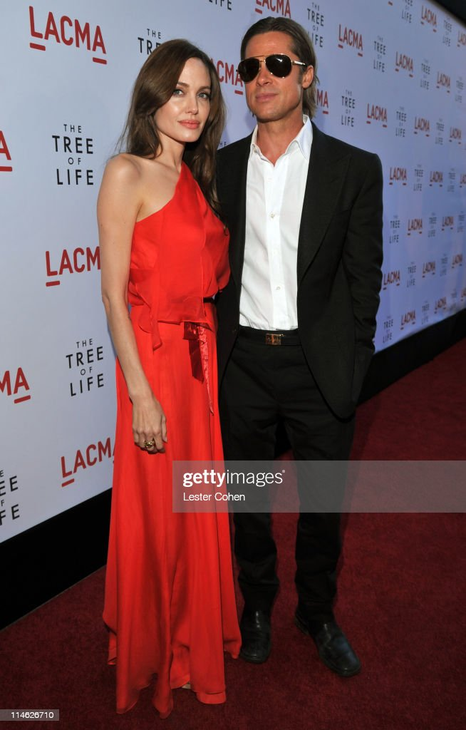 Actors Angelina Jolie and Brad Pitt arrive at 'The Tree Of Life' Los Angeles Premiere at Bing Theatre at the Los Angeles County Museum of Art on May...