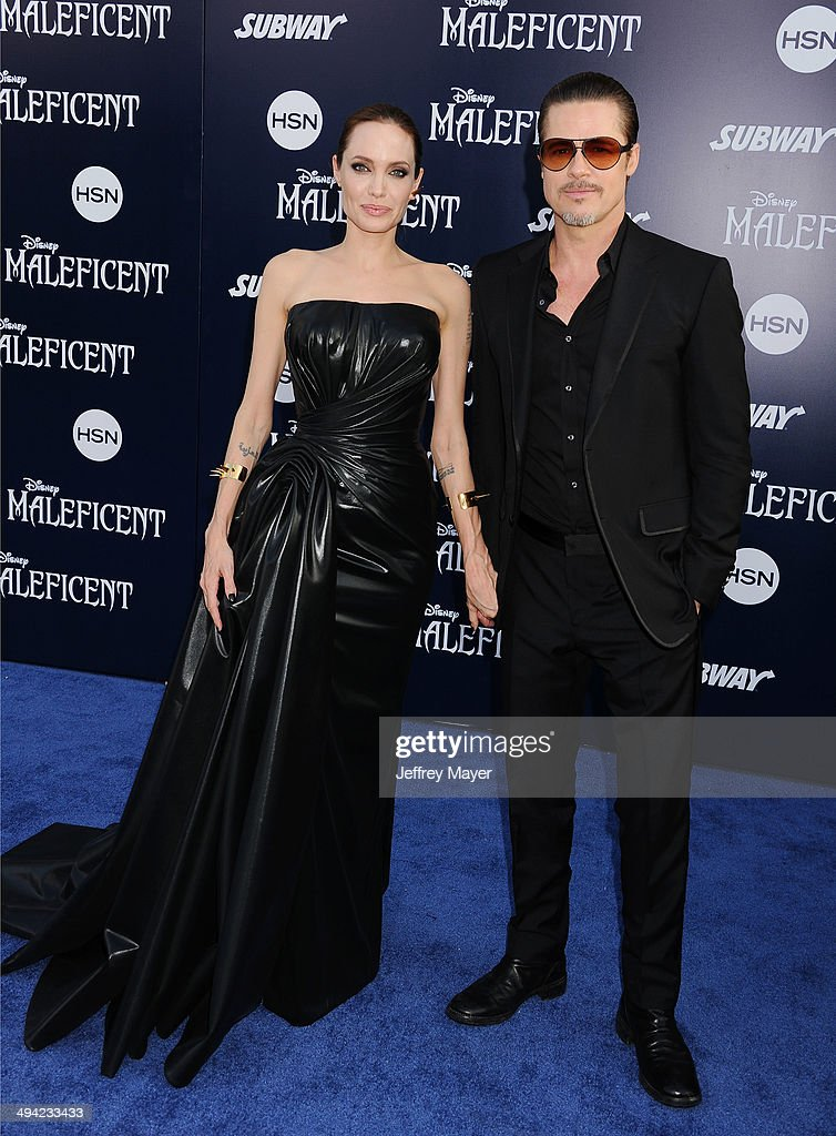 Actors <a gi-track='captionPersonalityLinkClicked' href=/galleries/search?phrase=Angelina+Jolie&family=editorial&specificpeople=201591 ng-click='$event.stopPropagation()'>Angelina Jolie</a> and <a gi-track='captionPersonalityLinkClicked' href=/galleries/search?phrase=Brad+Pitt+-+Actor&family=editorial&specificpeople=201682 ng-click='$event.stopPropagation()'>Brad Pitt</a> arrive at the World Premiere Of Disney's 'Maleficent' at the El Capitan Theatre on May 28, 2014 in Hollywood, California.