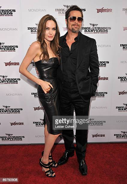Actors Angelina Jolie and Brad Pitt arrive on the red carpet of the Los Angeles premiere of 'Inglorious Basterds' at the Grauman's Chinese Theatre on...