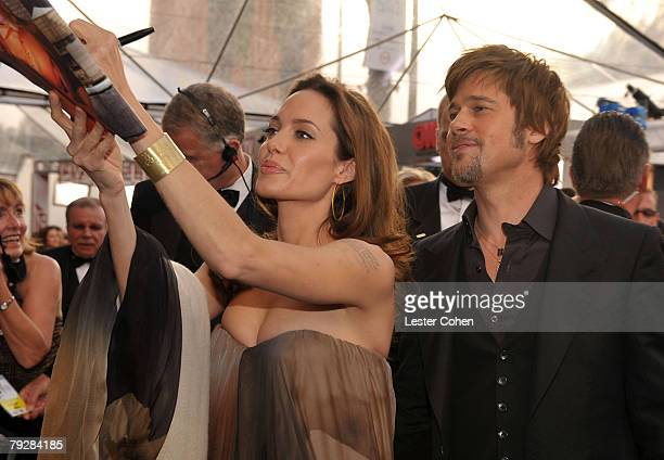 Actors Angelina Jolie and Brad Pitt arrive to the TNT/TBS broadcast of the 14th Annual Screen Actors Guild Awards at the Shrine Auditorium on January...