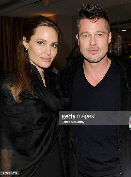 Actors Angelina Jolie and Brad Pitt attend GREY GOOSE Hosted '12 Years A Slave' Dinner at Sunset Tower on March 1 2014 in West Hollywood California