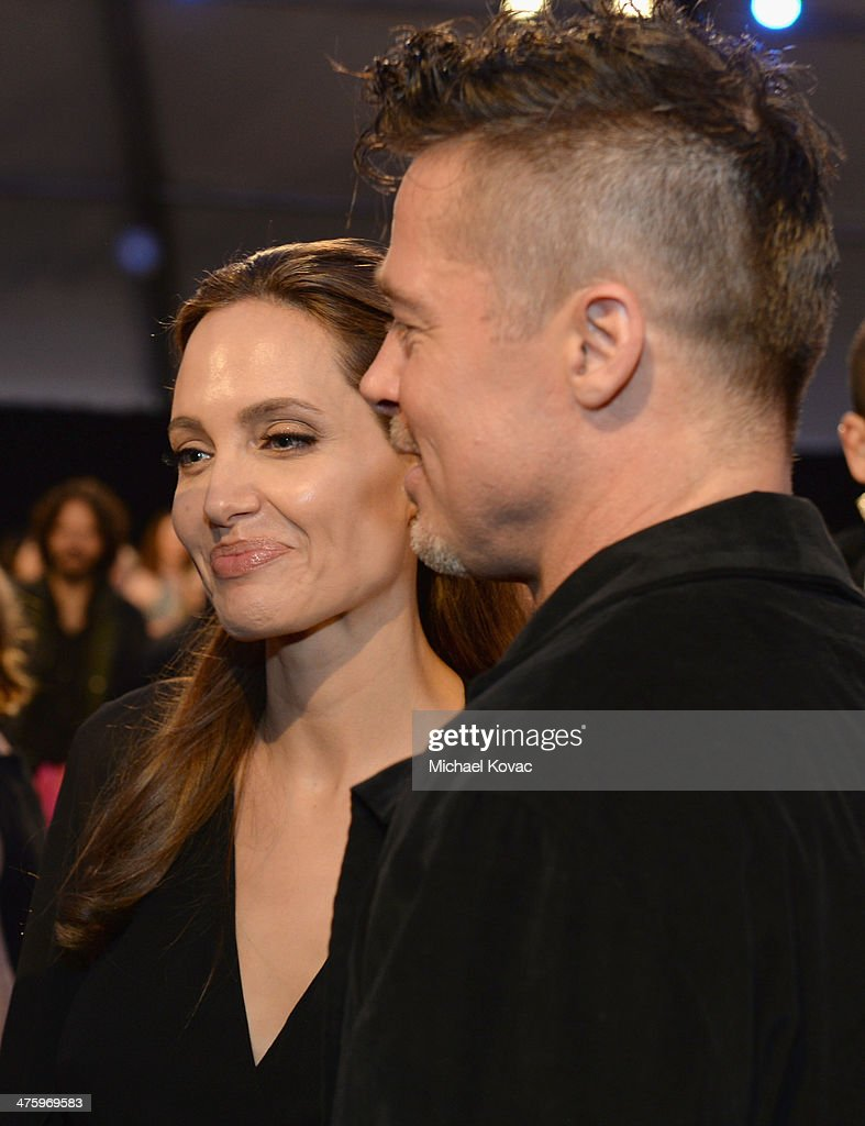 Actors Angelina Jolie (L) and Brad Pitt attend the 2014 Film Independent Spirit Awards at Santa Monica Beach on March 1, 2014 in Santa Monica, California.