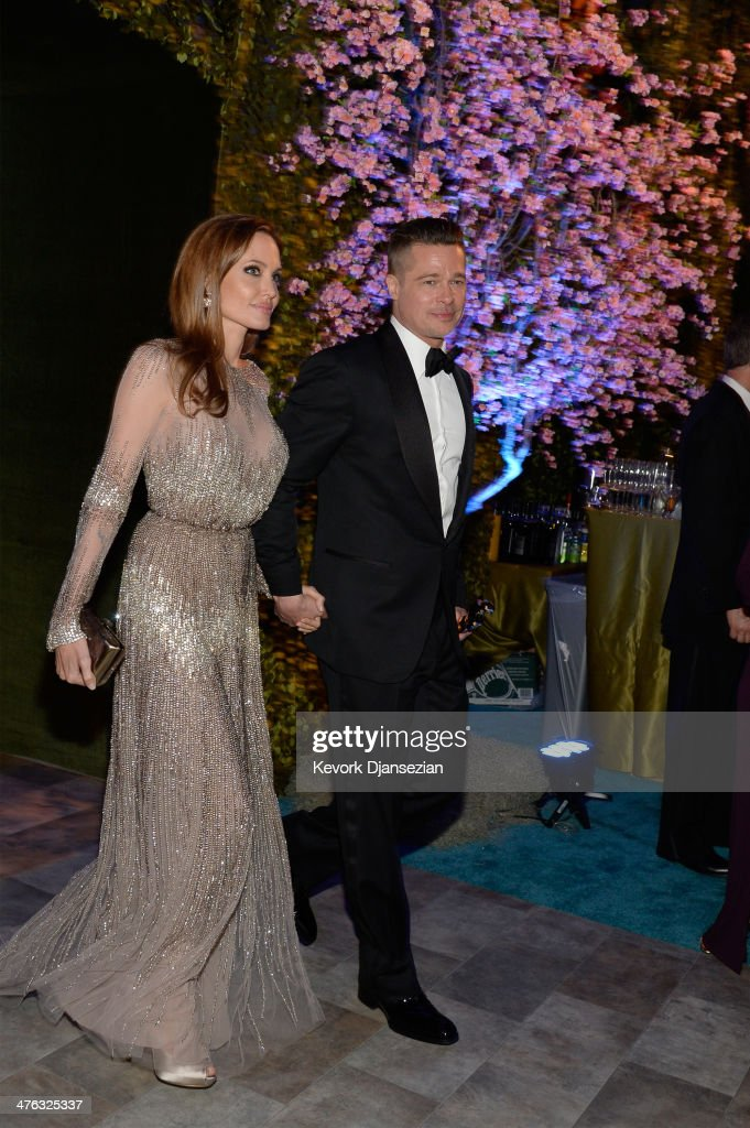 Actors Angelina Jolie and Brad Pitt attend the Oscars Governors Ball at Hollywood & Highland Center on March 2, 2014 in Hollywood, California.