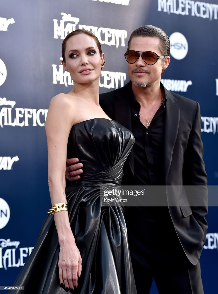 Actors <a gi-track='captionPersonalityLinkClicked' href=/galleries/search?phrase=Angelina+Jolie&family=editorial&specificpeople=201591 ng-click='$event.stopPropagation()'>Angelina Jolie</a> (L) and <a gi-track='captionPersonalityLinkClicked' href=/galleries/search?phrase=Brad+Pitt+-+Actor&family=editorial&specificpeople=201682 ng-click='$event.stopPropagation()'>Brad Pitt</a> attend the World Premiere of Disney's 'Maleficent' at the El Capitan Theatre on May 28, 2014 in Hollywood, California.