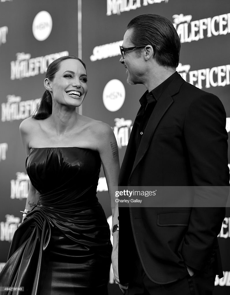 Actors <a gi-track='captionPersonalityLinkClicked' href=/galleries/search?phrase=Angelina+Jolie&family=editorial&specificpeople=201591 ng-click='$event.stopPropagation()'>Angelina Jolie</a> and <a gi-track='captionPersonalityLinkClicked' href=/galleries/search?phrase=Brad+Pitt+-+Actor&family=editorial&specificpeople=201682 ng-click='$event.stopPropagation()'>Brad Pitt</a> attend the World Premiere of Disney's 'Maleficent', starring <a gi-track='captionPersonalityLinkClicked' href=/galleries/search?phrase=Angelina+Jolie&family=editorial&specificpeople=201591 ng-click='$event.stopPropagation()'>Angelina Jolie</a>, at the El Capitan Theatre on May 28, 2014 in Hollywood, California.