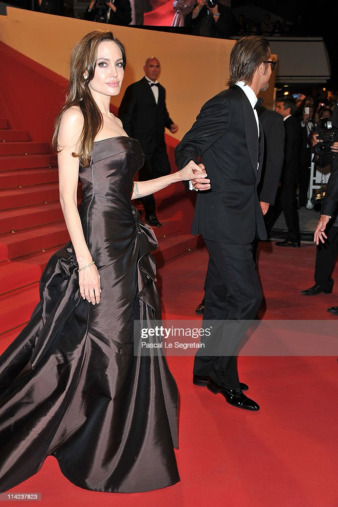 Actors <a gi-track='captionPersonalityLinkClicked' href=/galleries/search?phrase=Angelina+Jolie&family=editorial&specificpeople=201591 ng-click='$event.stopPropagation()'>Angelina Jolie</a> (L) and <a gi-track='captionPersonalityLinkClicked' href=/galleries/search?phrase=Brad+Pitt+-+Schauspieler&family=editorial&specificpeople=201682 ng-click='$event.stopPropagation()'>Brad Pitt</a> depart 'The Tree Of Life' premiere during the 64th Annual Cannes Film Festival at Palais des Festivals on May 16, 2011 in Cannes, France.