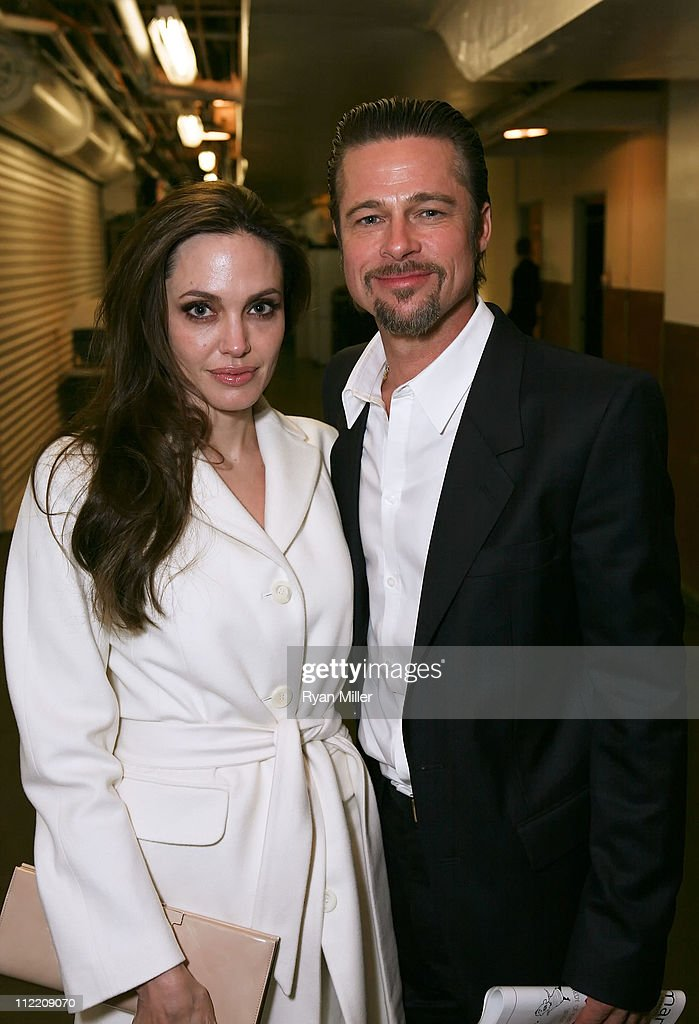 Actors Angelina Jolie (L) and Brad Pitt (R) pose backstage after the opening night performance of 'God of Carnage' at Center Theatre Group's Ahmanson Theatre on April 13, 2011 in Los Angeles, California.