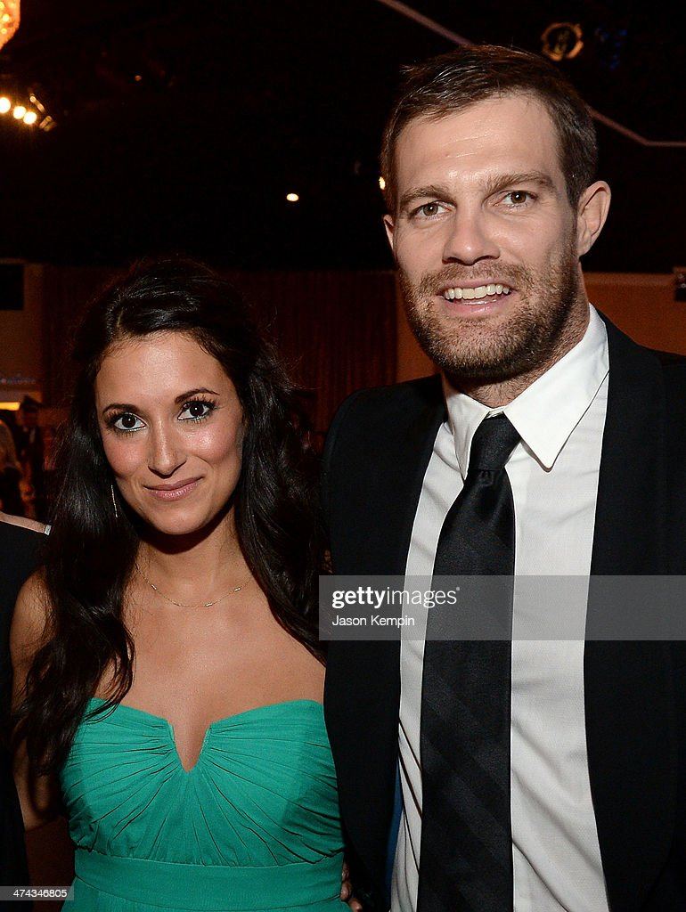 Actors Angelique Cabral (L) and Geoff Stults attend the 16th Costume Designers Guild Awards with presenting sponsor Lacoste at The Beverly Hilton Hotel on February 22, 2014 in Beverly Hills, California.