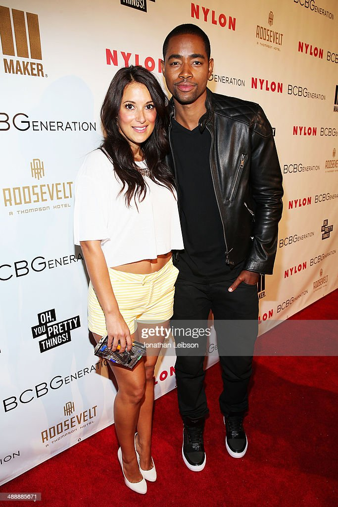Actors Angelique Cabral (L) and Jay Ellis attend the Nylon + BCBGeneration May Young Hollywood Party at Hollywood Roosevelt Hotel on May 8, 2014 in Hollywood, California.