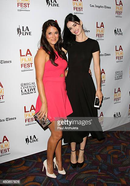 Actors Angelique Cabral and Krysten Ritter attend the premiere of 'The Road Within' at the 2014 Los Angeles Film Festival at Regal Cinemas LA Live on...