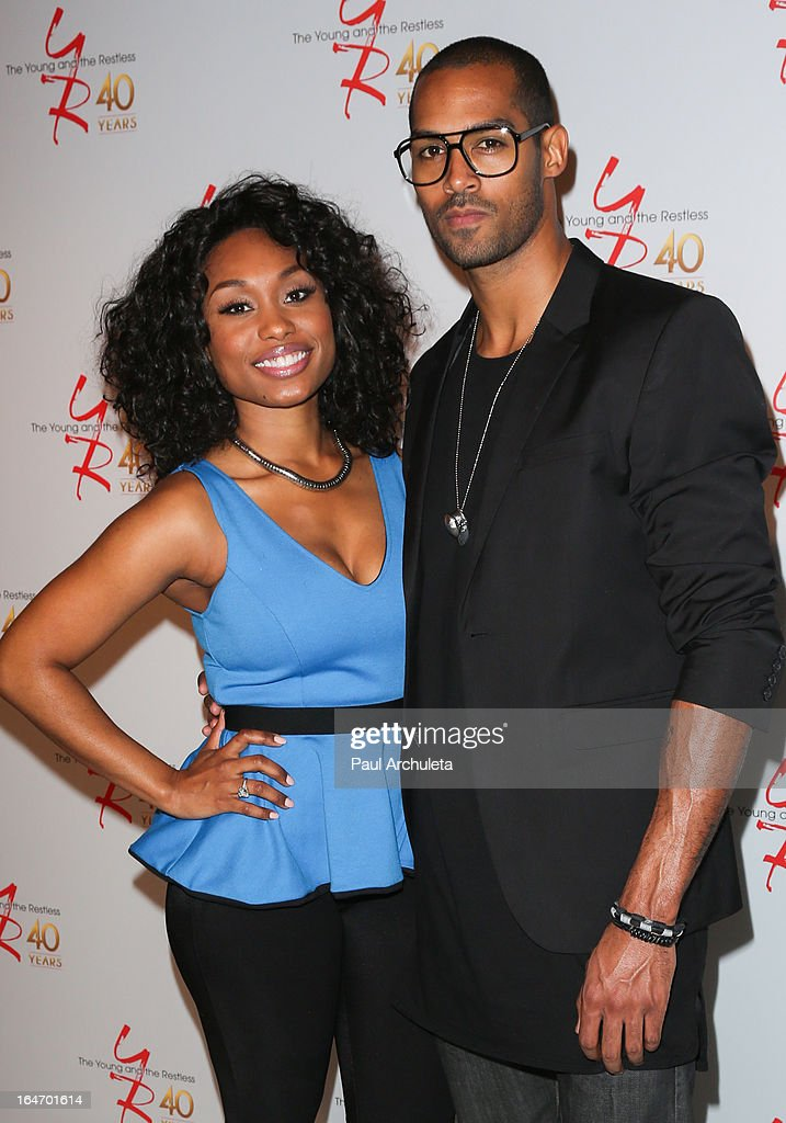 Actors <a gi-track='captionPersonalityLinkClicked' href=/galleries/search?phrase=Angell+Conwell&family=editorial&specificpeople=240300 ng-click='$event.stopPropagation()'>Angell Conwell</a> (L) and Lamon Archey (R) attend 'The Young & The Restless' 40th anniversary cake cutting ceremony at CBS Television City on March 26, 2013 in Los Angeles, California.