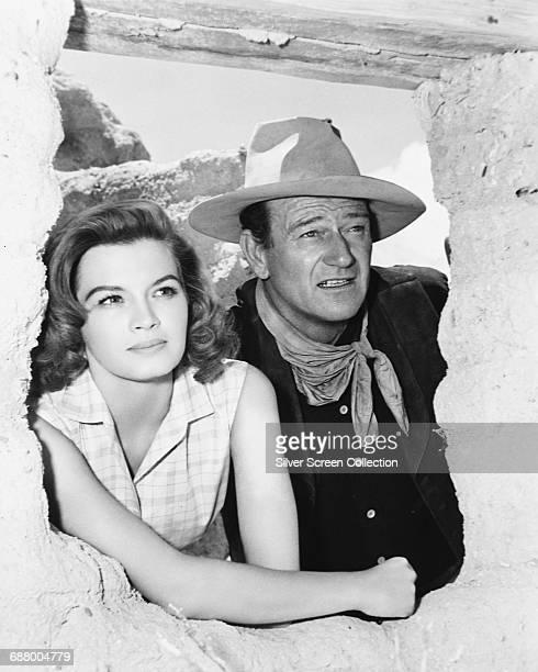 Actors Angie Dickinson and John Wayne star in the western 'Rio Bravo' 1959