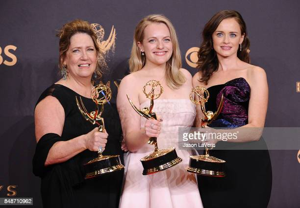 Actors Ann Dowd Elisabeth Moss and Alexis Bledel winners of the award for Outstanding Drama Series for 'The Handmaid's Tale' pose in the press room...