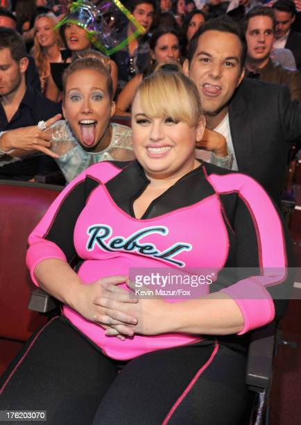 Actors Anna Camp Rebel Wilson and Skylar Astin attend the 2013 Teen Choice Awards at Gibson Amphitheatre on August 11 2013 in Universal City...
