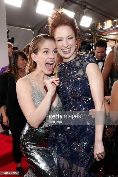 Actors Anna Chlumsky and Ellie Kemper walk the red carpet during the 69th Annual Primetime Emmy Awards at Microsoft Theater on September 17 2017 in...