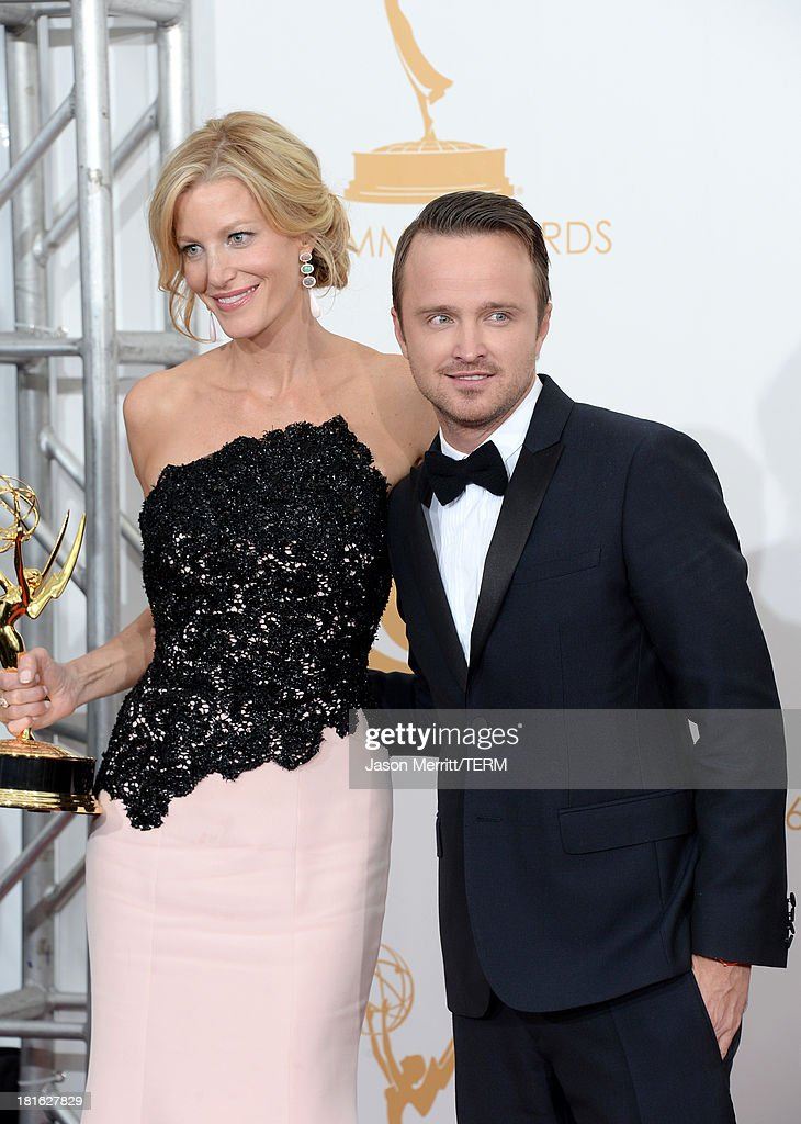 Actors <a gi-track='captionPersonalityLinkClicked' href=/galleries/search?phrase=Anna+Gunn&family=editorial&specificpeople=589359 ng-click='$event.stopPropagation()'>Anna Gunn</a> (L) and <a gi-track='captionPersonalityLinkClicked' href=/galleries/search?phrase=Aaron+Paul+-+Actor&family=editorial&specificpeople=693211 ng-click='$event.stopPropagation()'>Aaron Paul</a>, winners of the Best Drama Series Award for 'Breaking Bad' pose in the press room during the 65th Annual Primetime Emmy Awards held at Nokia Theatre L.A. Live on September 22, 2013 in Los Angeles, California.