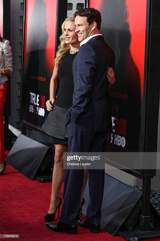 Actors Anna Paquin (L) and Stephen Moyer arrive at HBO's 'True Blood' season 6 premiere at ArcLight Cinemas Cinerama Dome on June 11, 2013 in Hollywood, California.