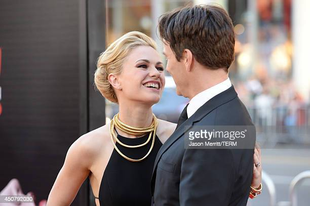 Actors Anna Paquin and Stephen Moyer attend the premiere of HBO's 'True Blood' season 7 and final season at TCL Chinese Theatre on June 17 2014 in...