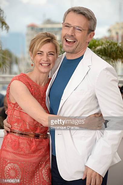 Actors Anne Consigny and Lambert Wilson pose at the 'Vous N'avez Encore Rien Vu' Photocall during the 65th Annual Cannes Film Festival at Palais des...