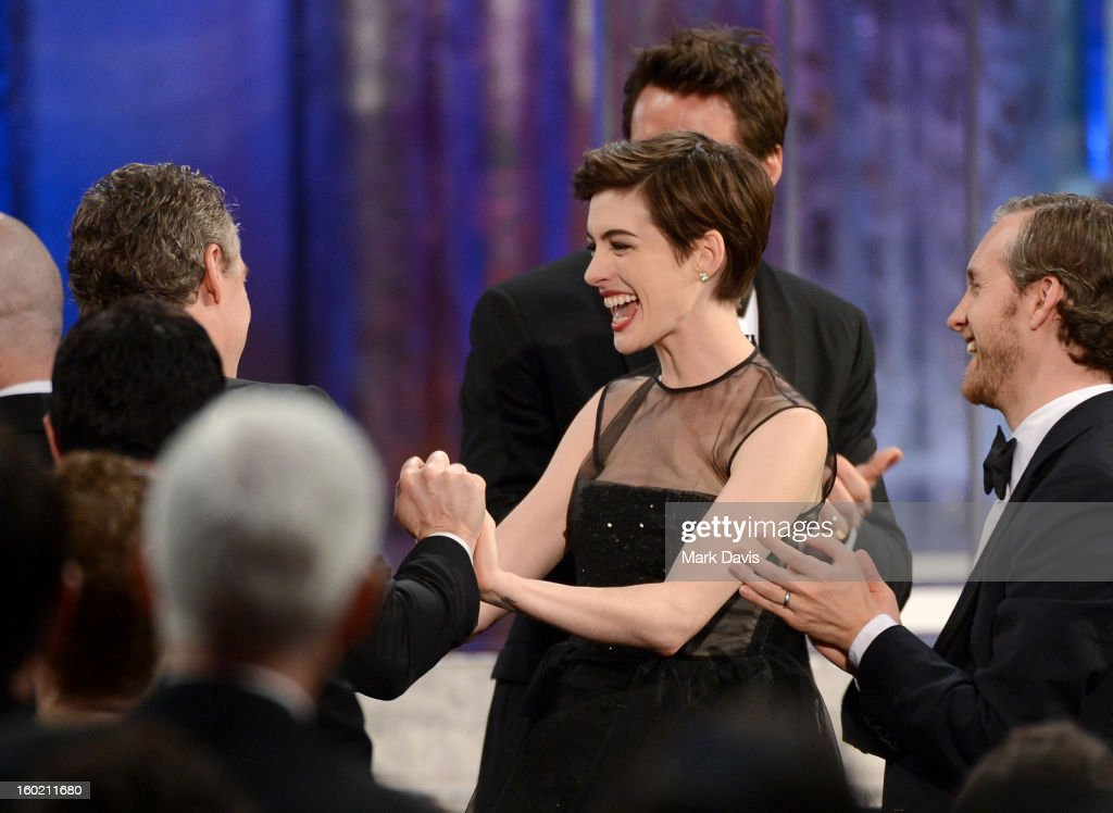 Actors <a gi-track='captionPersonalityLinkClicked' href=/galleries/search?phrase=Anne+Hathaway+-+Actress&family=editorial&specificpeople=11647173 ng-click='$event.stopPropagation()'>Anne Hathaway</a> (L) and <a gi-track='captionPersonalityLinkClicked' href=/galleries/search?phrase=Adam+Shulman&family=editorial&specificpeople=4682498 ng-click='$event.stopPropagation()'>Adam Shulman</a> attend the 19th Annual Screen Actors Guild Awards held at The Shrine Auditorium on January 27, 2013 in Los Angeles, California.