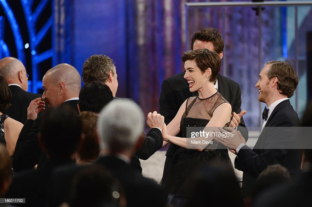 Actors <a gi-track='captionPersonalityLinkClicked' href=/galleries/search?phrase=Anne+Hathaway+-+Actress&family=editorial&specificpeople=11647173 ng-click='$event.stopPropagation()'>Anne Hathaway</a> (C) and <a gi-track='captionPersonalityLinkClicked' href=/galleries/search?phrase=Adam+Shulman&family=editorial&specificpeople=4682498 ng-click='$event.stopPropagation()'>Adam Shulman</a> (far right) attend the 19th Annual Screen Actors Guild Awards held at The Shrine Auditorium on January 27, 2013 in Los Angeles, California.