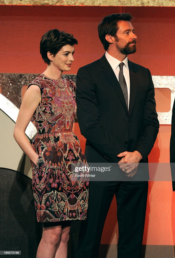Actors Anne Hathaway and Hugh Jackman onstage during the 65th Annual Directors Guild Of America Awards at Ray Dolby Ballroom at Hollywood & Highland on February 2, 2013 in Los Angeles, California.