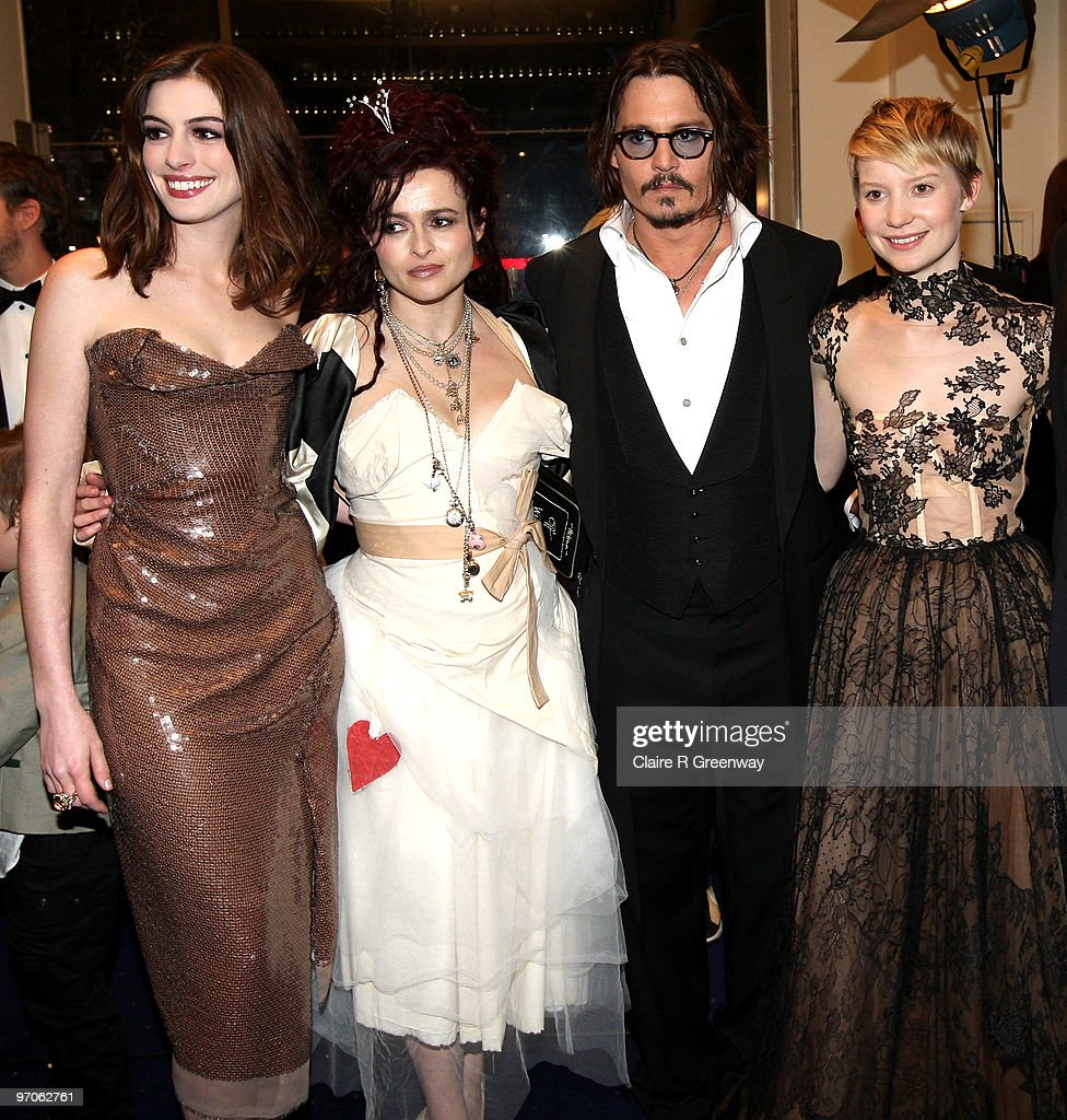 Actors Anne Hathaway Helena Bonham Carter Johnny Depp and Mia Wasikowska attend the Royal World Premiere of 'Alice In Wonderland' at Odeon Leicester...