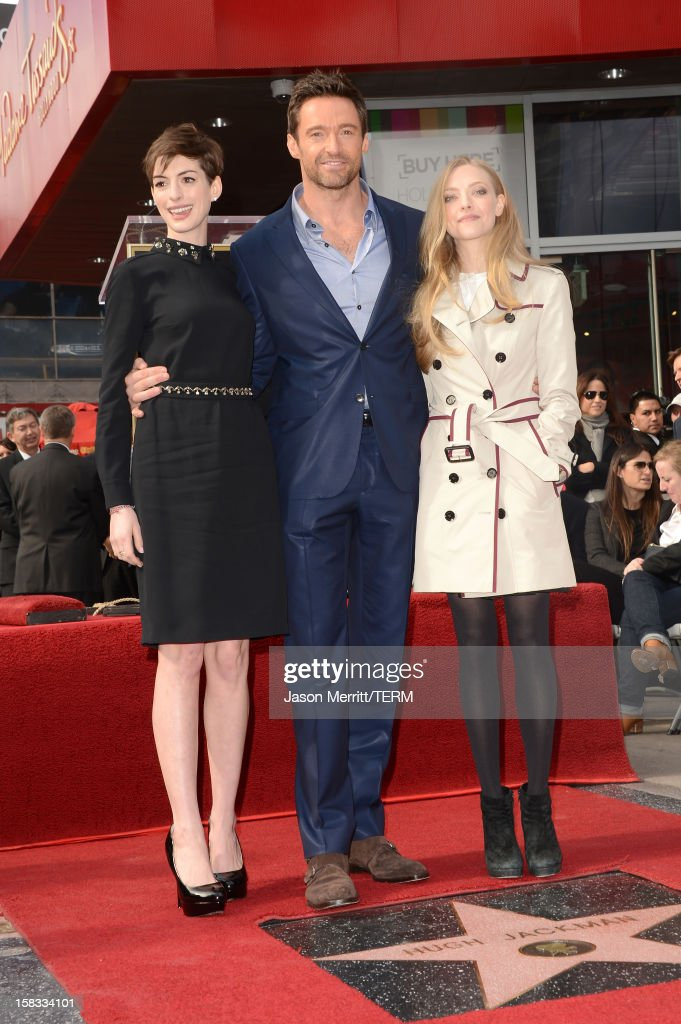 Actors Anne Hathaway, Hugh Jackman, and Amanda Seyfried attend the Hugh Jackman Hollywood Walk Of Fame ceremony on December 13, 2012 in Hollywood, California.