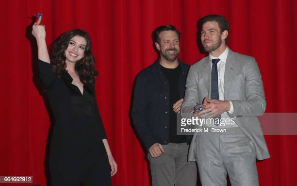 Actors Anne Hathaway Jason Sudeikis and Austin Stowell attend the Premiere Of Neon's 'Colossal' at the Vista Theatre on April 4 2017 in Los Angeles...