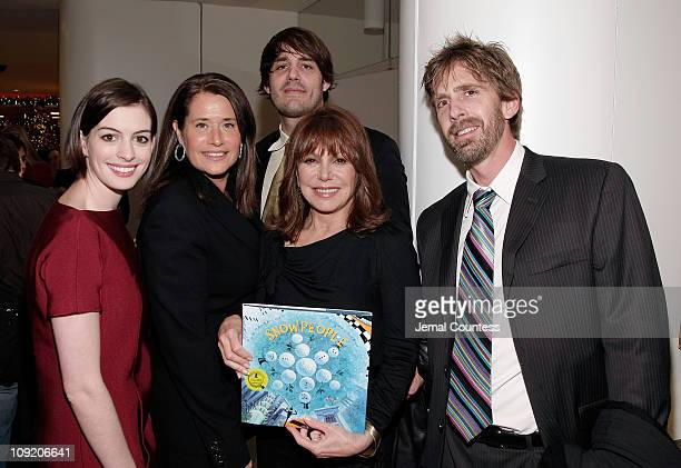 Actors Anne Hathaway Lorraine Bracco and Marlo Thomas pose with the Authors of 'The Snow People Ryan Zeeb and Rick Zeeb at the PreParty for the Saks...
