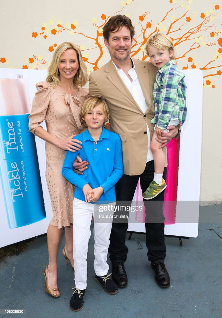 Actors <a gi-track='captionPersonalityLinkClicked' href=/galleries/search?phrase=Anne+Heche&family=editorial&specificpeople=202988 ng-click='$event.stopPropagation()'>Anne Heche</a> (L) and <a gi-track='captionPersonalityLinkClicked' href=/galleries/search?phrase=James+Tupper&family=editorial&specificpeople=619618 ng-click='$event.stopPropagation()'>James Tupper</a> (R) attend the launch of her 'Tickle Time Sunblock' at The COOP on December 8, 2012 in Studio City, California.