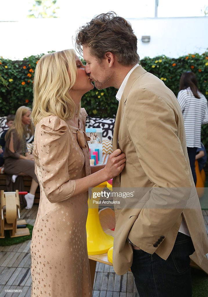 Actors Anne Heche (L) and James Tupper (R) attend the launch of her 'Tickle Time Sunblock' at The COOP on December 8, 2012 in Studio City, California.