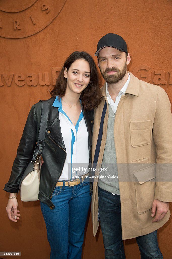 Actors Anne Serra and Alban Lenoir attends the 2016 French tennis Open day 3, at Roland Garros on May 24, 2016 in Paris, France.