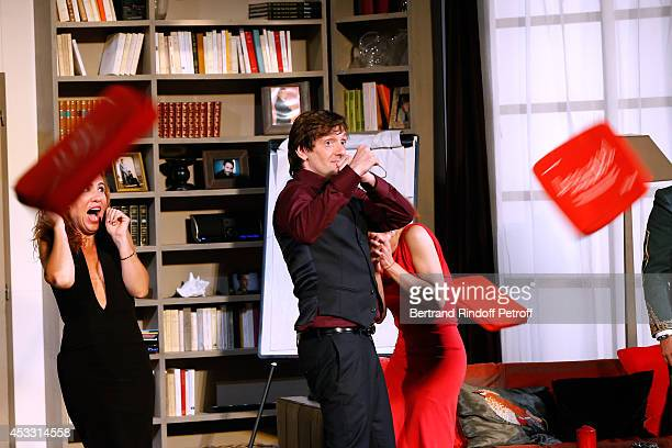 Actors AnneElisabeth Blateau Pierre Palmade and Noemie de Lattre during the traditional throw of cushions at the final of 'Le fils du comique' play...