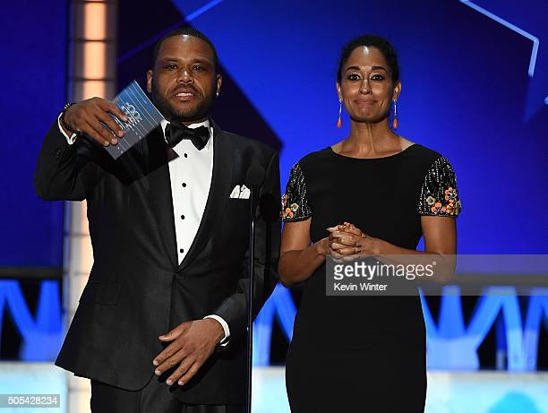Actors Anthony Anderson and Tracee Ellis Ross speak onstage during the 21st Annual Critics' Choice Awards at Barker Hangar on January 17 2016 in...