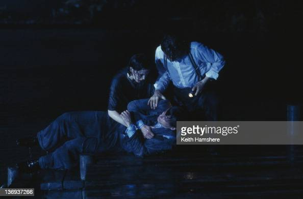 Actors Anthony Andrews and Kate Beckinsale pull Aidan Quinn from the lake in a scene from the film 'Haunted' 1995